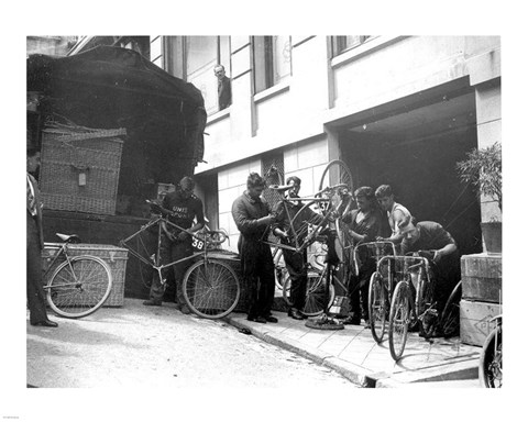 Taking care of  maintenance of the racing bicycles during a rest day in Belfort
