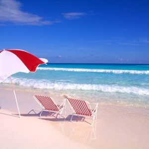 Tropical beach art of colorful beach umbrella and chair