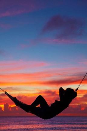 Woman in hammock at sunset, Coral Coast, Viti Levu, Fiji