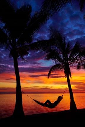 Woman in hammock, and palm trees at sunset, Coral Coast, Viti Levu, Fiji