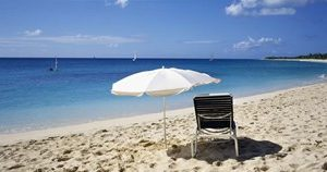 Single Beach Chair And Umbrella On Sand, Saint Martin, French West Indies